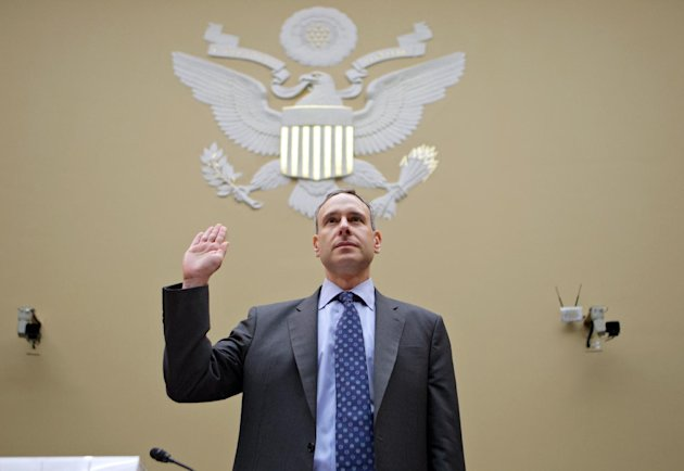 Internal Revenue Service (IRS) Commissioner Douglas Shulman is sworn in on Capitol Hill in Washington, Thursday, Aug. 2, 2012, prior to testifying before the House Oversight Committee. Can the IRS police President Barack Obama's health care mandate while simultaneously collecting all the taxes for running the federal government? The question is being renewed in the wake of the Supreme Court's decision upholding most of the 2010 Affordable Care Act as a tax issue rather than one of interstate commerce. (AP Photo/J. Scott Applewhite)