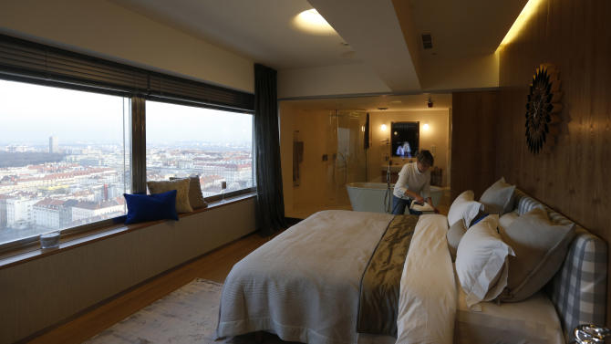 In this picture taken March 6, 2013, an employee prepares  a hotel room at the Zizkov television tower in Prague, Czech Republic.  Seventy-three meters above the ground, the six-star luxurious room is available for 1,000 euro (US $1,305) per night since its opening on Feb 13. (AP Photo/Petr David Josek)