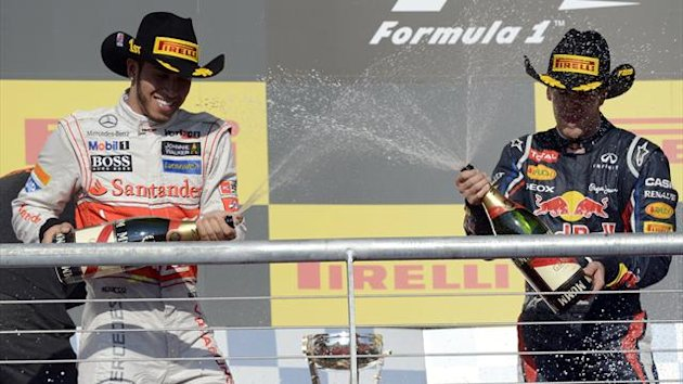 Britain&#39;s Lewis Hamilton (L) of Team Vodafone McLaren Mercedes celebrates on the podium after winning the United States Formula One Grand Prix at the Circuit of the Americas (AFP)