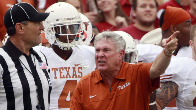 Texas head coach Mack Brown yells at an official during the first half of an NCAA college football game against Oklahoma at the Cotton Bowl Saturday, Oct. 13, 2012, in Dallas. (AP Photo/Michael Mulvey)