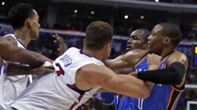 Los Angeles Clippers forward Matt Barnes, left and Clippers forward Blake Griffin, second from left, tangle with Oklahoma City Thunder forward Serge Ibaka, second from right, of Congo, and Thunder guard Russell Westbrook, right, in the first half of their NBA basketball game Wednesday, Nov. 13, 2013, in Los Angeles. Ibaka and Barnes were ejected from the game after the scuffle. (AP Photo/Alex Gallardo)