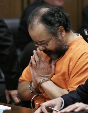 FILE - In this Aug. 1, 2013 file photo, Ariel Castro bows his head in the courtroom during his sentencing sentencing in Cleveland. Castro, 53, now serving a life sentence for the kidnapping and rape, was found hanging in his cell, Tuesday night, Sept. 3, 2013, at the Correctional Reception Center in Orient, Ohio. (AP Photo/Tony Dejak, FILE)