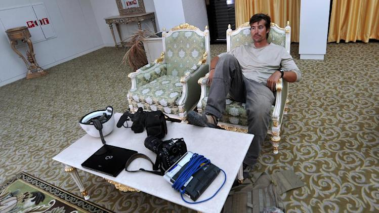 US freelance reporter James Foley rests in a room at the airport of Sirte, Libya on September 29, 2011