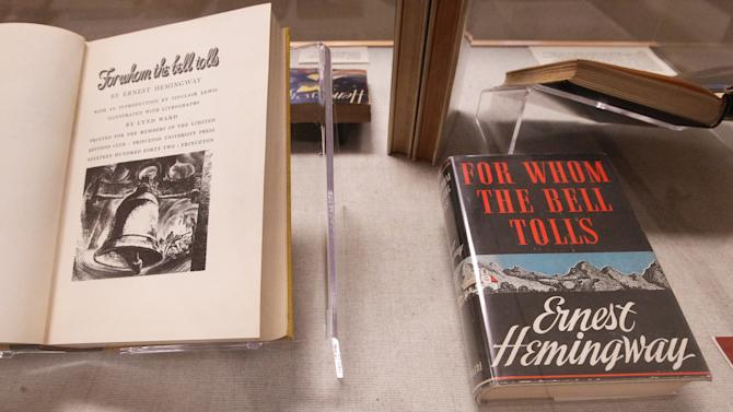 "At left is a 1942 edition of ""For Whom the Bell Tolls"" with an introduction by Sinclair Lewis and on the right is a 1940 copy on display at the University of South Carolina in Columbia, S.C. Tuesday Sept. 25, 2012.  The University of South Carolina Libraries is now home to the most complete collection of Ernest Hemingway's published work, thanks to a newly acquired collection of more than 1,200 items of the 20th century American writer. (AP Photo/The State,Tim Dominick ) ALL LOCAL MEDIA OUT, (TV, ONLINE, PRINT)"