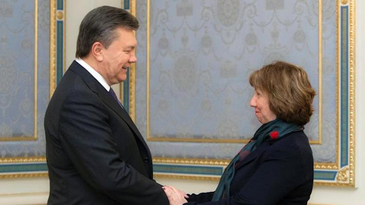 A handout picture released by Ukrainian presidency press office shows Ukrainian president Viktor Yanukovych (L) meeting EU foreign policy chief Catherine Ashton  in Kiev on December 10, 2013