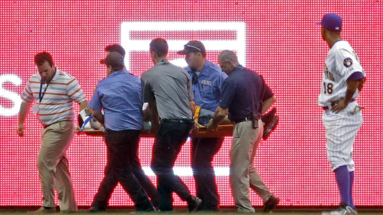 Brewers lose to Twins, game delayed after fan fall