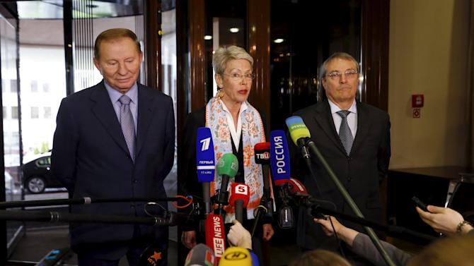 OSCE Ambassador Tagliavini, former Ukrainian President Kuchma and ambassador-at-large representing Russia Kulmukhametov address the media after the meeting of the so-called Contact Group in Minsk