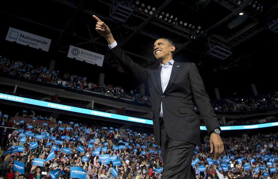 President Barack Obama points to the crowd as he arrives to speak at a campaign event at Nationwide Arena, Monday, Nov. 5, 2012, in Columbus, Ohio.  (AP Photo/Carolyn Kaster)
