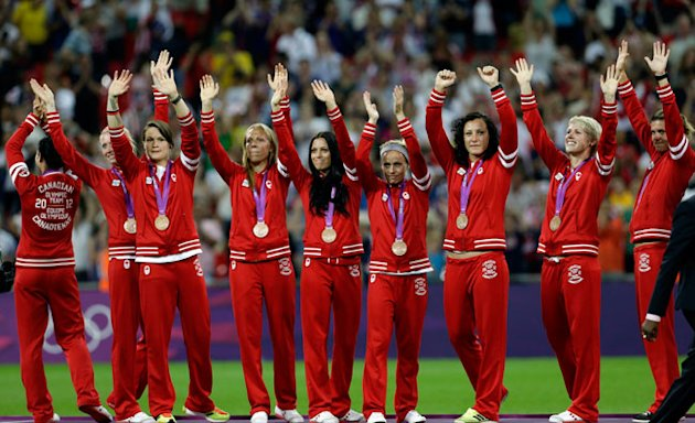 Canada players celebrate winning the bronze medal during the women's soccer ceremonies at the 2012 Summer Olympics (Canadian Press)