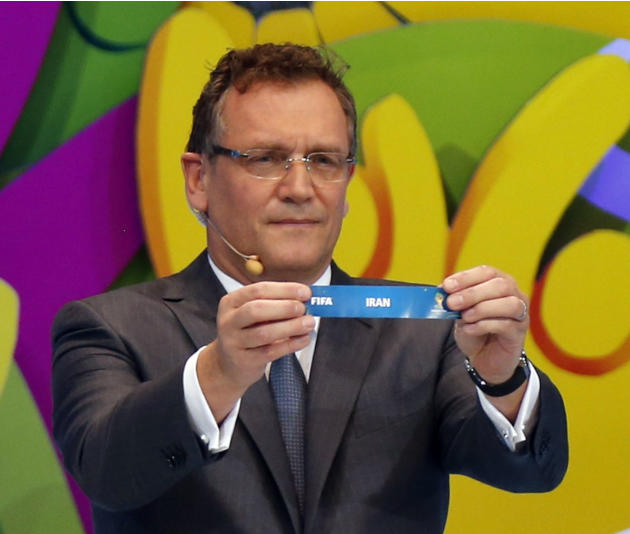 "FIFA Secretary General Jerome Valcke holds the slip showing ""Iran"" during the draw for the 2014 World Cup at the Costa do Sauipe resort in Sao Joao da Mata"