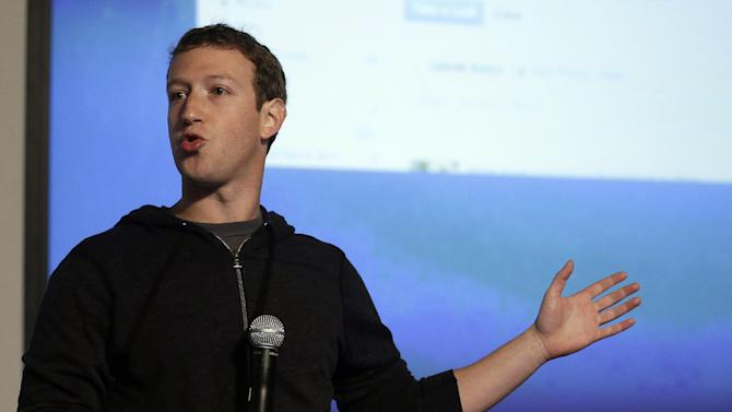 "FILE - In this Jan. 15, 2013 file photo, Facebook CEO Mark Zuckerberg speaks at Facebook headquarters in Menlo Park, Calif. The expansion of H-1b visas is considered the first major victory for Zuckerberg's new non-profit lobbying organization, FWD.us, which receives financial backing from such big tech names as Bill Gates of Microsoft, Reid Hoffman of LinkedIn and Napster pioneer Sean Parker. In announcing the group, pronounced ""forward us,"" Zuckerberg in April called for changes so that U.S. businesses could attract ""the most talented and hardest-working people, no matter where they were born."" (AP Photo/Jeff Chiu, File)"