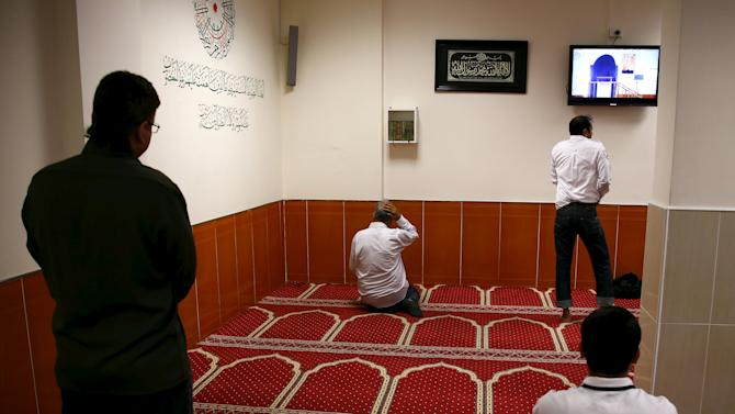 Worshippers take part in a prayer session at the Parramatta mosque in western Sydney, Australia