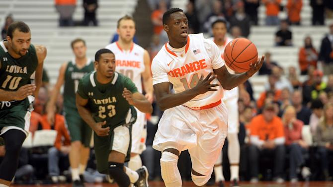 Syracuse's Kelb Joseph brings the ball up court on a fast break against Loyola during the first half of an NCAA college basketball game in Syracuse, N.Y., Tuesday, Nov. 25, 2014. (Kevin Rivoli/AP Photo)