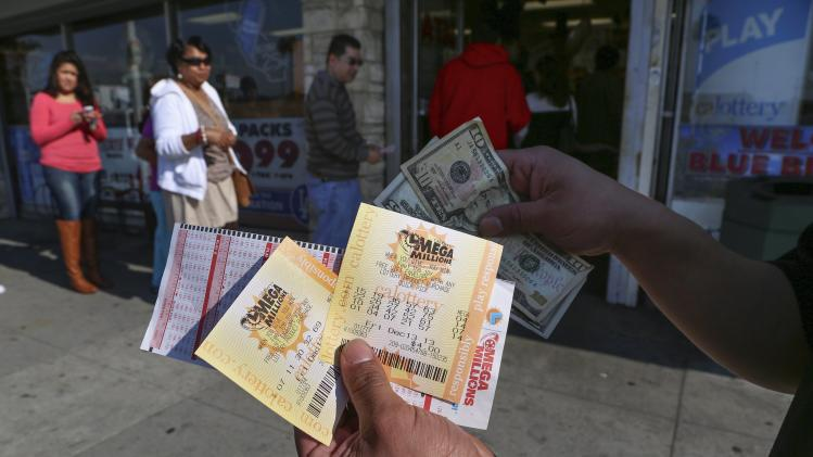A man shows his recently purchased Mega Millions lottery tickets at Bluebird Liquor in Hawthorne, California