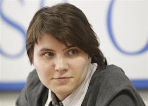 Samutsevich, freed member of the Russian punk band Pussy Riot, takes part in a news conference in Moscow