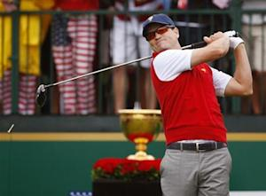 U.S. golfer Zach Johnson tees off during the Singles matches for the 2013 Presidents Cup golf tournament at Muirfield Village Golf Club in Dublin
