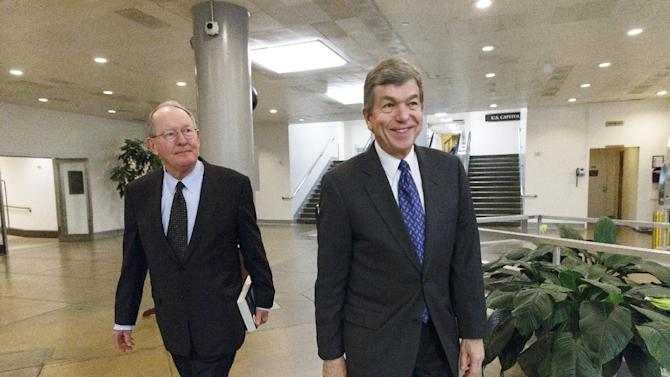 Sen. Lamar Alexander, R-Tenn., left, and Sen. Roy Blunt, R-Mo. return to their offices on Capitol Hill in Washington, Thursday, Jan. 16, 2014, during a short recess as the Senate worked to get final congressional approval for an immense $1.1 trillion spending package, a bipartisan compromise that all but banishes the likelihood of an election-year government shutdown, Thursday, Jan. 16, 2014. The legislation is a follow-up to the budget compromise the two parties pushed through Congress in December that set overall spending limits for the next two years. (AP Photo/J. Scott Applewhite)
