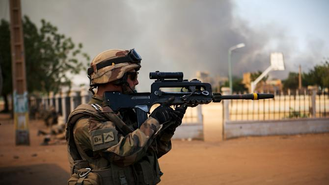 A French soldier battles radical Islamic rebels in Gao, Mali, Thursday, Feb. 21, 2013. Islamic extremists clashed with military in Mali's northern city of Gao, a military official said Thursday, as French and Malian forces continued their push to eliminate remnants of al-Qaida-linked fighters who had controlled northern Mali. Malian military spokesman Capt. Daouda Diarra said that fighters with the Movement for Oneness and Jihad in West Africa, or MUJAO, attacked a Gao checkpoint late Wednesday and made their way into the city. (AP Photo)