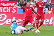 FC Bayern Munich midfielder Arjen Robben (C) challanges Napoli's midfielder Marek Hamsik for the ball during a friendly football match at Municipal Stadium in Arco, Italy. Bayern Munich fell 3-2 to Napoli