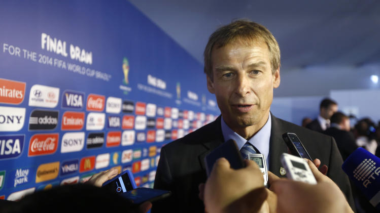 United States head coach Juergen Klinsmann from Germany answers journalists' question after the draw ceremony for the 2014 soccer World Cup in Costa do Sauipe near Salvador, Brazil, Friday, Dec. 6, 2013. (AP Photo/Victor R. Caivano)