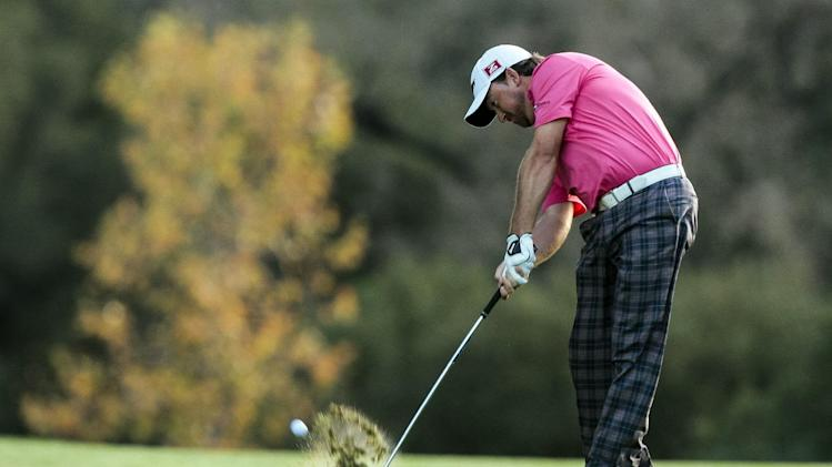 Graeme McDowell hits his second shot during the final round of the World Challenge golf tournament at Sherwood Country Club in Thousand Oaks, Calif., Sunday, Dec. 2, 2012. (AP Photo/Bret Hartman)