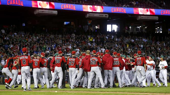 Canada and Mexico fight during the ninth inning of a World Baseball Classic game, Saturday, March 9, 2013, in Phoenix. (AP Photo/Matt York)