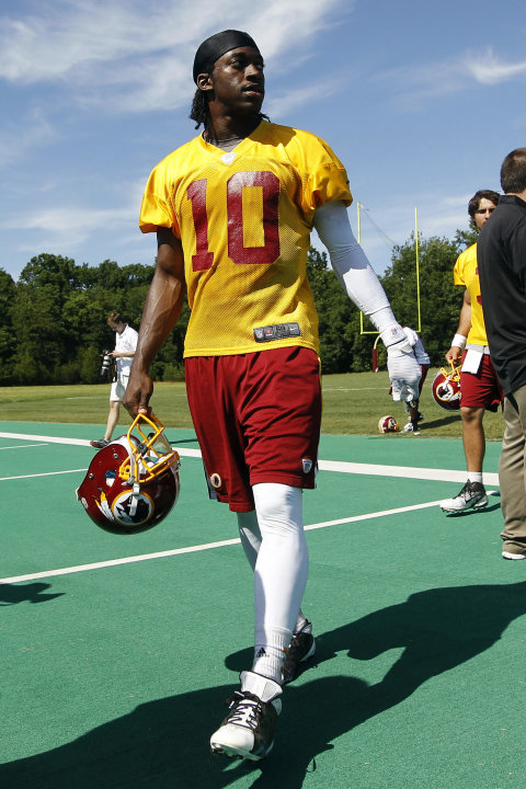 FILE - In this June 13, 2012, file photo, Washington Redskins quarterback Robert Griffin III walks off the field following NFL football practice in Ashburn, Va. Former Baylor basketball player Richard