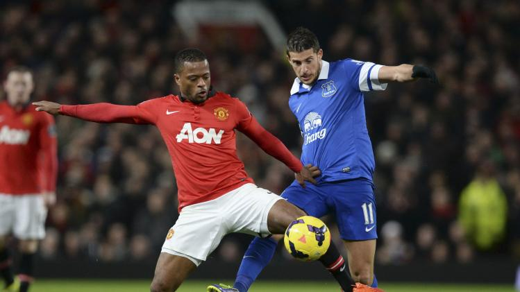 Everton's Mirallas challenges Manchester United's Evra during their English Premier League match at Old Trafford in Manchester