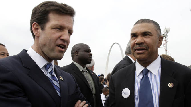 FILE - In this April 19, 2010, file photo  Rep. Russ Carnahan, D-Mo., left, and Rep. William Lacy Clay, D-Mo., attend a groundbreaking ceremony in St. Louis. As colleagues in Congress and heirs of prominent political families,  Carnahan and Clay have cordially represented St. Louis for several years. Now the two Democrats are accusing one another of lying.  That's what can happen when two congressmen are matched up in a single district because of once-every-decade redrawing of political boundaries. (AP Photo/Jeff Roberson, File)