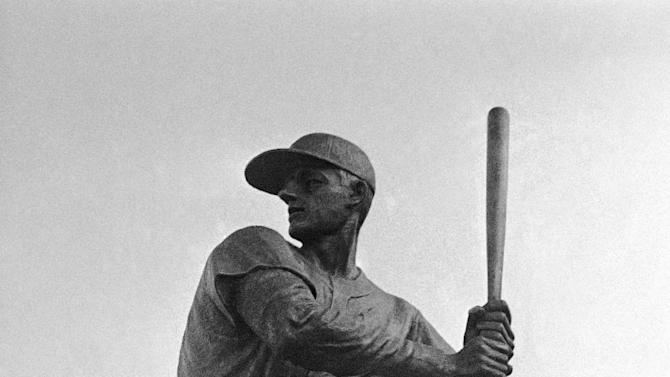 FILE - In this Aug. 4, 1968, file photo, former St. Louis Cardinals baseball player Stan Musial stand near a statue of him at the plate, outside Busch Stadium in St. Louis. Musial, one of baseball's greatest hitters and a Hall of Famer with the Cardinals for more than two decades, has died. He was 92. Stan the Man won seven National League batting titles, was a three-time MVP and helped the Cardinals capture three World Series championships in the 1940s. The Cardinals announced Musial's death in a news release. They said he died Saturday evening, Jan. 19, 2013, at his home surrounded by family. (AP Photo/Fred Waters, File)