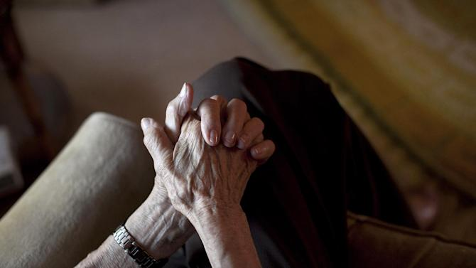 In this Dec. 28, 2011 photo, 100-year-old Minka Disbrow holds her hands together during an interview with the Associated press in her apartment in San Clemente, Calif. Disbrow, who was raped at age 16, has lived to be 100 - long enough to meet the daughter she gave up at birth 77 years earlier and learn about the six grandchildren she didn't know she had. One of them is a space shuttle astronaut. (AP Photo/Jae C. Hong)