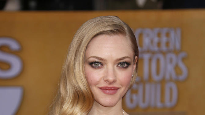 Amanda Seyfried arrives at the 19th Annual Screen Actors Guild Awards at the Shrine Auditorium in Los Angeles on Sunday Jan. 27, 2013. (Photo by Todd Williamson/Invision for The Hollywood Reporter/AP Images)