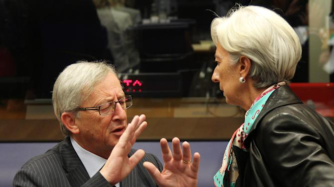 Luxembourg's Prime Minister and President of the Eurogroup Jean-Claude Juncker, left, talks with International Monetary Fund managing director Christine Lagarde, during the Eurogroup meeting, in Luxembourg, Monday Oct. 8, 2012. Finance ministers from the nations sharing the euro currency assess the latest developments in the financial crisis. (AP Photo/Yves Logghe)
