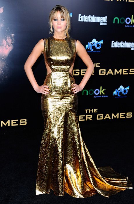 Jennifer Lawrence is a golden girl at the world premiere of 'The Hunger Games' in Los Angeles, March 12. Lawrence wears a stunning Prabal Gurung dress with cut-out panels at the side. We love the futu
