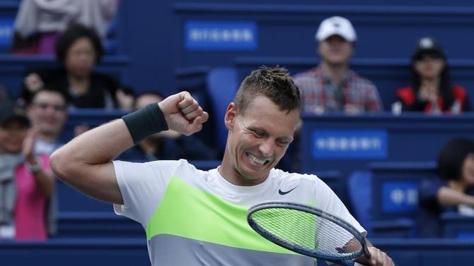 Tomas Berdych of the Czech Republic celebrates after defeating Jo-Wilfried Tsonga of France in their men's singles quarterfinal match at the Shanghai Masters tennis tournament at Qizhong Forest Sports City Tennis Center in Shanghai, China, Friday Oct. 12, 2012. Tomas Berdych won 6-3, 7-6 (4). (AP Photo/Kin Cheung)