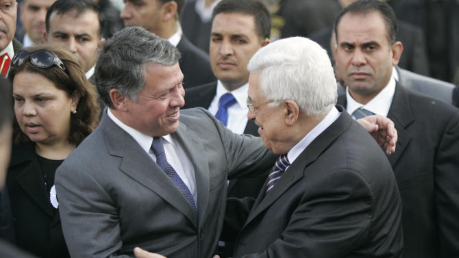 King Abdullah II of Jordan, left, is greeted by Palestinian President Mahmoud Abbas, as he arrives in the West Bank city of Ramallah, Monday, Nov. 21, 2011. King Abdullah II is paying a rare visit to the West Bank to show support for Palestinian President Mahmoud Abbas. Monday's trip comes as the two moderate leaders seek rapprochement with the Islamic militant Hamas. (AP Photo/Majdi Mohammed)