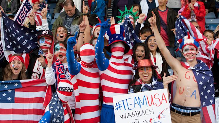U.S. supporters cheer during the group G women's soccer match between the United States and Colombia at the London 2012 Summer Olympics, Saturday, July 28, 2012, at Hampden Park Stadium in Glasgow, Scotland. (AP Photo/Chris Clark)