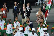 Sudan's flagbearer Ismail Ahmed Ismail (R) leads her delegation during the opening ceremony of the London 2012 Olympic Games on July 27, 2012 at the Olympic Stadium in London.    AFP PHOTO / GABRIEL BOUYS