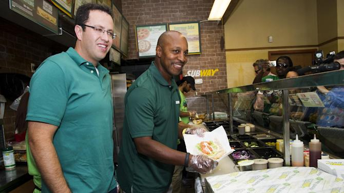 "IMAGE DISTRIBUTED FOR SUBWAY - Baseball all-star Willie Randolph, right, and Jared ""The SUBWAY Guy"" make sandwiches and give out the new limited edition SUBWAY bag that encourages healthier lifestyles on Tuesday, July 16, 2013 in New York. (Photo by Charles Sykes/Invision for SUBWAY/AP Images)"