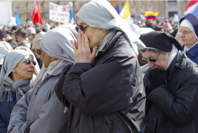 Nuns pray as they wait for Pope Benedict XVI's last Angelus prayer, in St. Peter's Square, at the Vatican, Sunday, Feb. 24, 2013. Benedict XVI gave his pontificate's final Sunday blessing from his stu