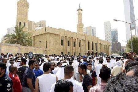 Crowds surround the Imam Sadiq Mosque after a bomb explosion following Friday prayers, in the Al Sawaber area of Kuwait City