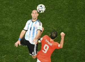 Argentina's Pablo Zabaleta is challenged by Robin van Persie of the Netherlands during extra time in their 2014 World Cup semi-finals at the Corinthians