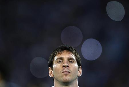 Argentina's Lionel Messi stands before their 2014 World Cup qualifying soccer match against Uruguay in Mendoza