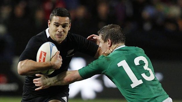 New Zealand All Blacks' Tamati Ellison (L) fends off Ireland's Brian O'Driscoll during their international rugby test match in Hamilton June 23, 2012 (Reuters)