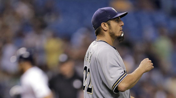 Milwaukee Brewers starting pitcher Matt Garza walks around the mound as Tampa Bay Rays' Ben Zobrist rounds the bases after his home run during the sixth inning of an interleague baseball game Tuesday, July 29, 2014, in St. Petersburg, Fla. (AP Photo/Chris O'Meara)