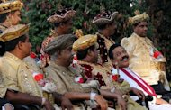 Sri Lanka President Mahinda Rajapakse (seated, L) and noblemen during the Esala Perahera festival at the president's official bungalow in Colombo in August. Sri Lanka's ruling party secured victory in three provincial council elections including one area ravaged by the island's ethnic war that ended in 2009, according to results released on Sunday