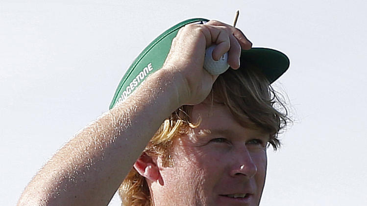 Brandt Snedeker adjusts his visor on the 17th tee during the third round of the Waste Management Phoenix Open golf tournament on Saturday, Feb. 2, 2013, in Scottsdale, Ariz. (AP Photo/Matt York)