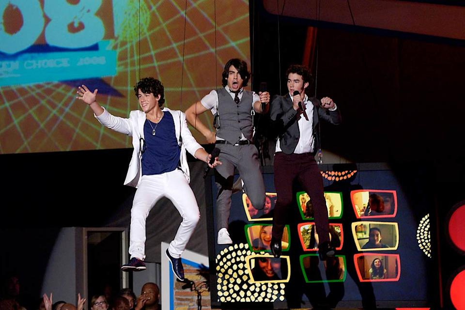 The Jonas Brothers take flight at the 2008 Teen Choice Awards at Gibson Amphitheater on August 3, 2008 in Los Angeles, California.