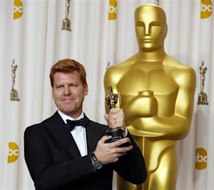 "John Kahrs poses with his Oscar for Best Animated Short Film for ""paperman"" at the 85th Academy Awards in Hollywood, California"