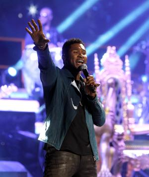 FILE - This Feb. 24, 2012 file photo shows Usher during a guest appearance at a Romeo Santos concert at Madison Square Garden, in New York.  Usher, nominated for video of the year, will also perform at the upcoming 2012 BET Awards at The Shrine Auditorium on July 1 in Los Angeles. (AP Photo/Jason DeCrow, File)